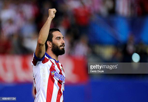 Arda Turan of Club Atletico de Madrid celebrates after scoring his team's opening goal during the UEFA Champions League Group A match between Club...
