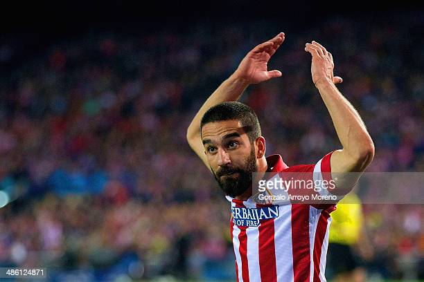 Arda Turan of Club Atletico de Madrid looks to the fans for encouragement during the UEFA Champions League Semi Final first leg match between Club...