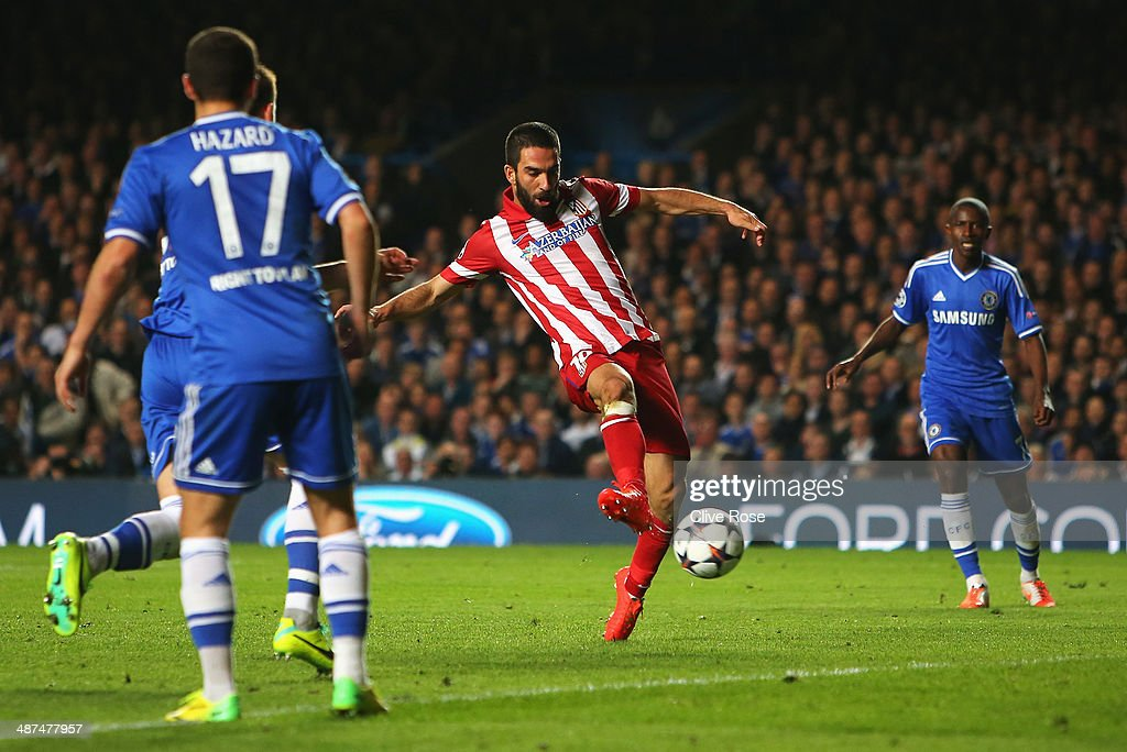 Arda Turan of Club Atletico de Madrid scores his team's third goal during the UEFA Champions League semi-final second leg match between Chelsea and Club Atletico de Madrid at Stamford Bridge on April 30, 2014 in London, England.