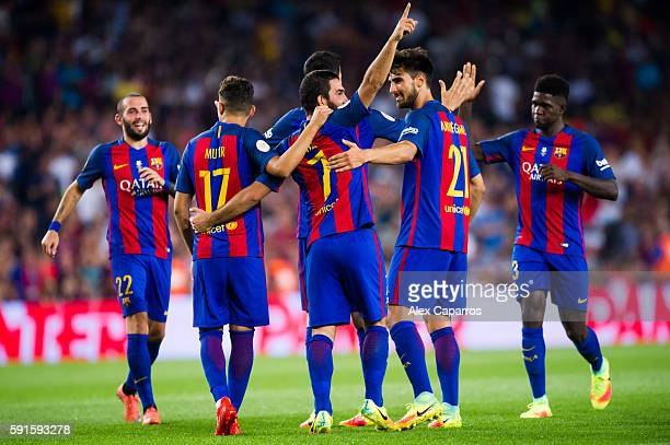 Arda Turan of FC Barcelona celebrates with his teammates Aleix Vidal Munir El Haddadi Andre Gomes and Samuel Umtiti after scoring his team's second...