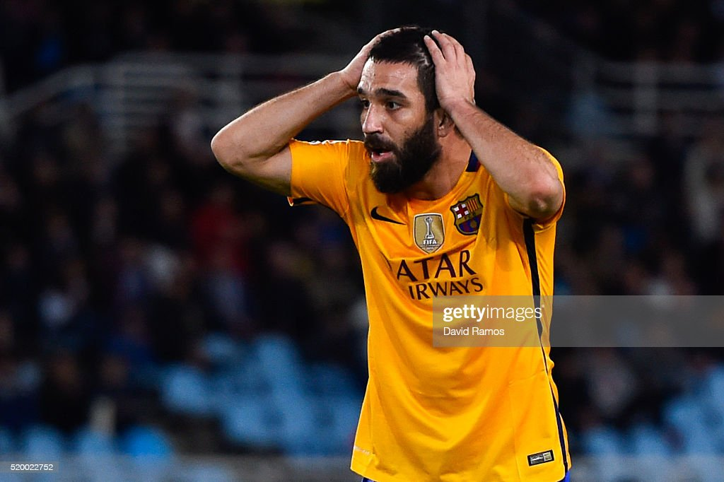 <a gi-track='captionPersonalityLinkClicked' href=/galleries/search?phrase=Arda+Turan&family=editorial&specificpeople=2179402 ng-click='$event.stopPropagation()'>Arda Turan</a> of FC Barcelona reacts after missing a chance to score during the La Liga match between Real Sociedad de Futbol and FC Barcelona at Estadio Anoeta on April 9, 2016 in San Sebastian, Spain.