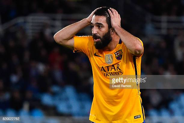 Arda Turan of FC Barcelona reacts after missing a chance to score during the La Liga match between Real Sociedad de Futbol and FC Barcelona at...