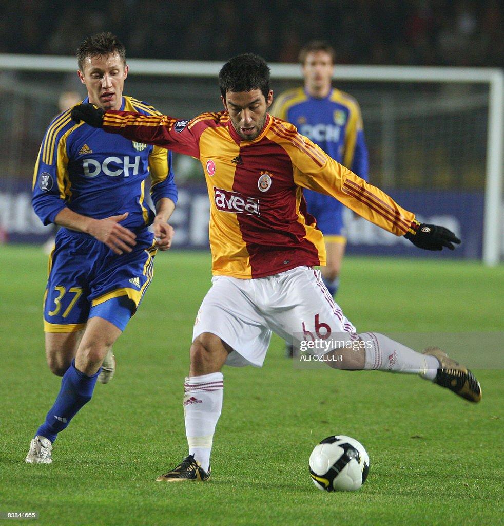 Arda Turan R of Galatasaray vies with