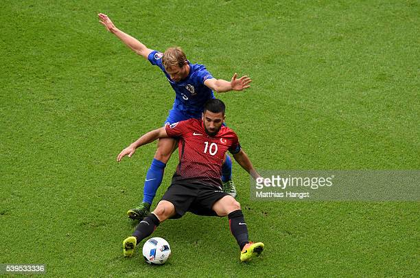 Arda Turan of Turkey controls the ball under pressure of Ivan Strinic of Croatia during the UEFA EURO 2016 Group D match between Turkey and Croatia...