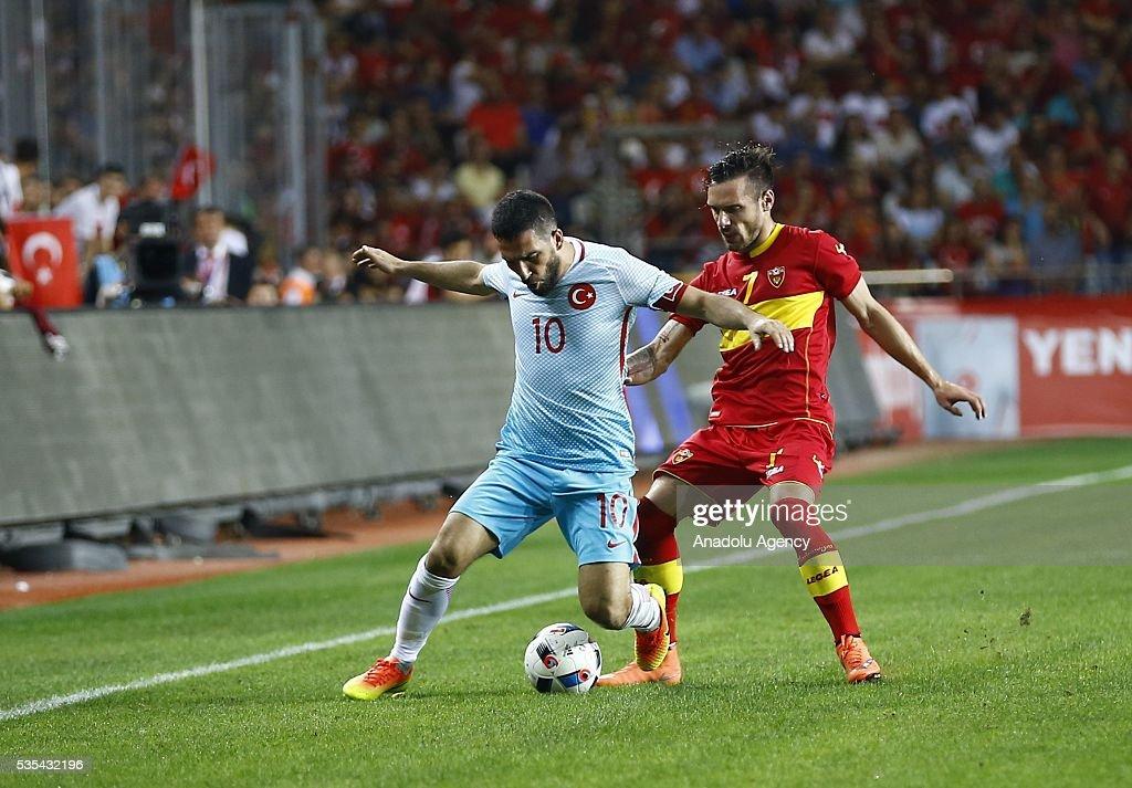 Arda Turan (L) of Turkey in action during the friendly football match between Turkey and Montenegro at Antalya Ataturk Stadium in Antalya, Turkey on May 29, 2016.