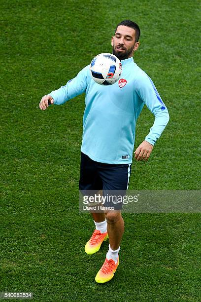 Arda Turan of Turkey juggles the ball during a training session ahead of their UEFA Euro 2016 Group D match against Spain at Allianz Riviera Stadium...
