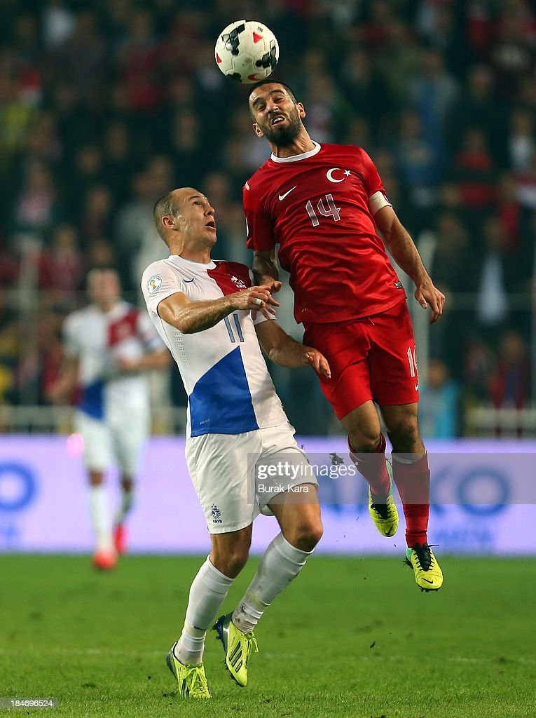 <a gi-track='captionPersonalityLinkClicked' href=/galleries/search?phrase=Arda+Turan&family=editorial&specificpeople=2179402 ng-click='$event.stopPropagation()'>Arda Turan</a> of Turkey jumps for a header over Netherlands <a gi-track='captionPersonalityLinkClicked' href=/galleries/search?phrase=Jordy+Clasie&family=editorial&specificpeople=7012011 ng-click='$event.stopPropagation()'>Jordy Clasie</a> during FIFA 2014 World Cup Qualifier match at the Sukru Saracoglu Stadium on October 15, 2013 in Istanbul, Turkey.