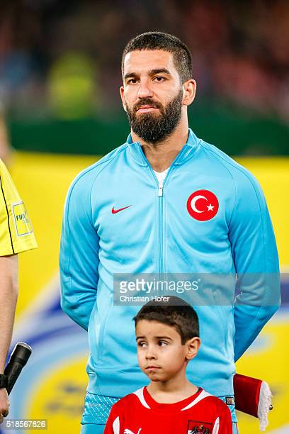 Arda Turan of Turkey lines up during the national anthem prior to the international friendly match between Austria and Turkey at ErnstHappelStadium...