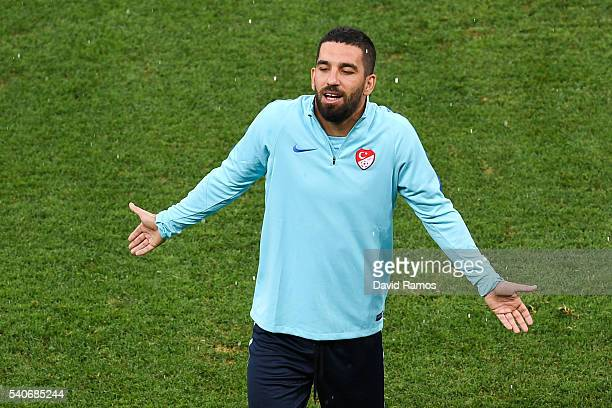 Arda Turan of Turkey reacts during a training session ahead of their UEFA Euro 2016 Group D match against Spain at Allianz Riviera Stadium on June 16...
