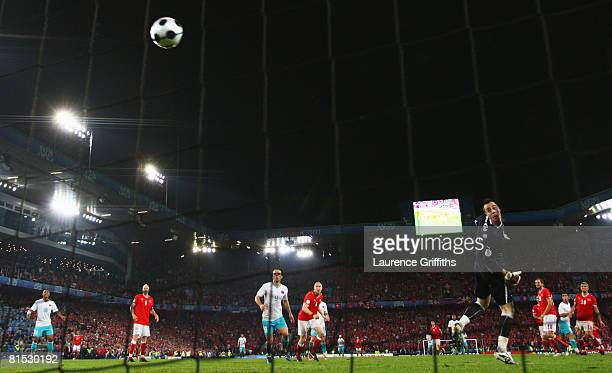 Arda Turan of Turkey shoots and scores his teams second goal as goalkeeper Diego Benaglio of Switzerland can only look on during the UEFA EURO 2008...