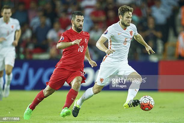 Arda Turan of Turkye Daley Blind of Holland during the UEFA Euro 2016 qualifying match between Turkey and Netherlands on September 6 2015 at the...