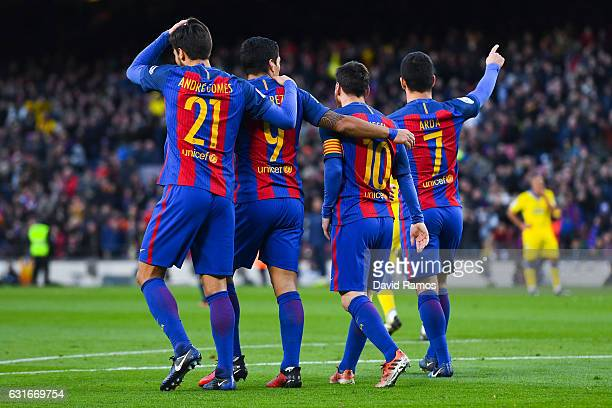 Ardan Turan of FC Barcelona celebrates with his team mates Andre Gomes Luis Suarez and Lionel Messi after scoring his team's fourth goalduring the La...