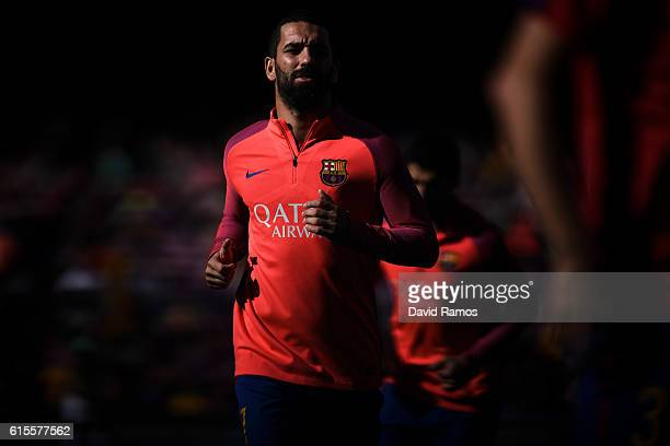 Ardan Turan of FC Barcelona looks on during the warm up prior to the La Liga match between FC Barcelona and RC Deportivo La Coruna at Camp Nou...