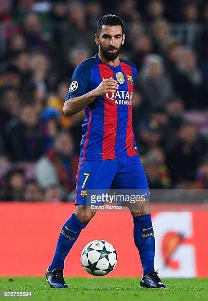 Ardan Turan of FC Barcelona runs with the ball during the UEFA Champions League match between FC Barcelona and VfL Borussia Moenchengladbach at Camp...