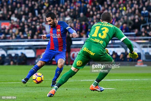 Ardan Turan of FC Barcelona scores his team's fourth goal during the La Liga match between FC Barcelona and UD Las Palmas at Camp Nou stadium on...