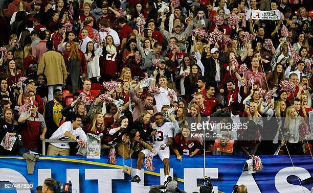 ArDarius Stewart of the Alabama Crimson Tide celebrates their 54 to 16 win over the Florida Gators during the SEC Championship game at the Georgia...