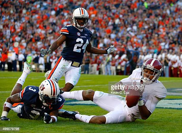 ArDarius Stewart of the Alabama Crimson Tide fails to pull in this touchdown reception against Jonathan Jones of the Auburn Tigers at Jordan Hare...