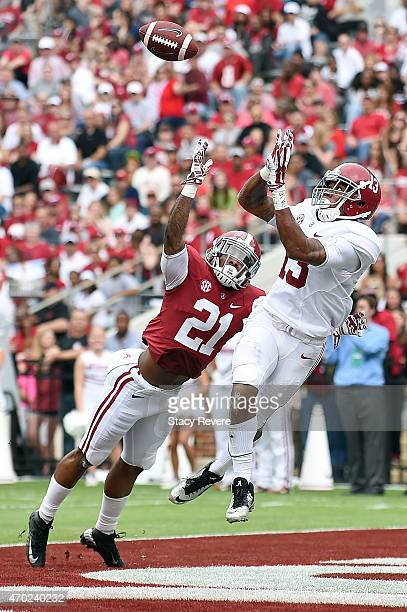ArDarius Stewart of the White team catches a touchdown pass in front of Maurice Smith of the Crimson team during the University of Alabama A Day...
