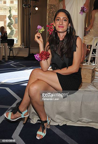 Arden Wohl poses for pictures during the Arden Wohl X Cri de Coeur presentation at The W Hotel Union Square on September 4 2014 in New York City