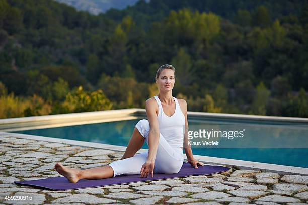 Blonde beautiful mature yoga stock photos and pictures for Half lord of the fishes