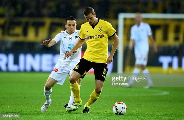 Ardian Gashi of Odd challenges Sven Bender of Borussia Dortmund the UEFA Europa League Play Off Round 2nd Leg match between Borussia Dortmund and...
