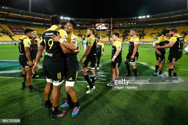Ardie Savea and Sam Lousi of the Hurricanes celebrate the win during the round four Super Rugby match between the Hurricanes and the Highlanders at...