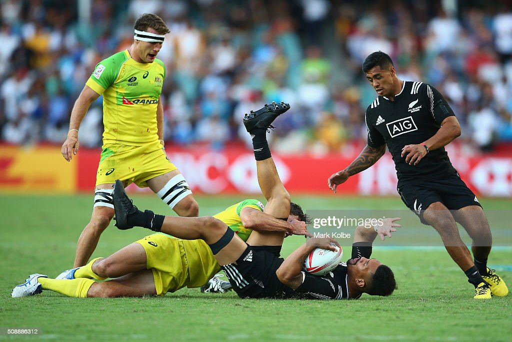 <a gi-track='captionPersonalityLinkClicked' href=/galleries/search?phrase=Ardie+Savea&family=editorial&specificpeople=8836502 ng-click='$event.stopPropagation()'>Ardie Savea</a> of New Zealand is tackled during the 2016 Sydney Sevens cup final match between Australia and New Zealand at Allianz Stadium on February 7, 2016 in Sydney, Australia.