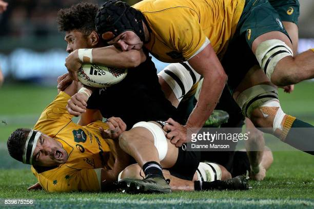 Ardie Savea of the All Blacks is tackled during The Rugby Championship Bledisloe Cup match between the New Zealand All Blacks and the Australia...