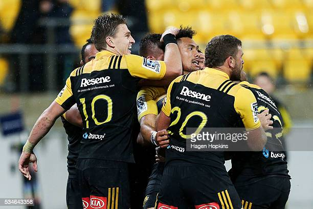 Ardie Savea of the Hurricanes is congratulated on his matchwinning try by teammate Beauden Barrett during the round 14 Super Rugby match between the...
