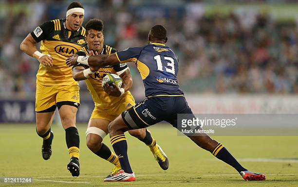 Ardie Savea of the Hurricanes is tackled by Tevita Kuridrani of the Brumbies during the round one Super Rugby match between the Brumbies and the...