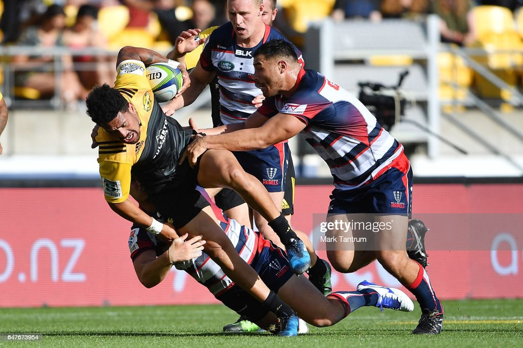 Ardie Savea of the Hurricanes is tackled during the round two Super Rugby match between the Hurricanes and the Rebels at Westpac Stadium on March 4, 2017 in Wellington, New Zealand.