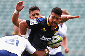 Ardie Savea of the Hurricanes is tackled during the Super Rugby preseason match between the Blues and the Hurricanes at QBE Stadium on February 6...