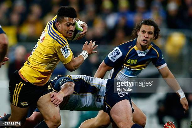 Ardie Savea of the Hurricanes is tackled during the Super Rugby Semi Final match between the Hurricanes and the Brumbies at Westpac Stadium on June...