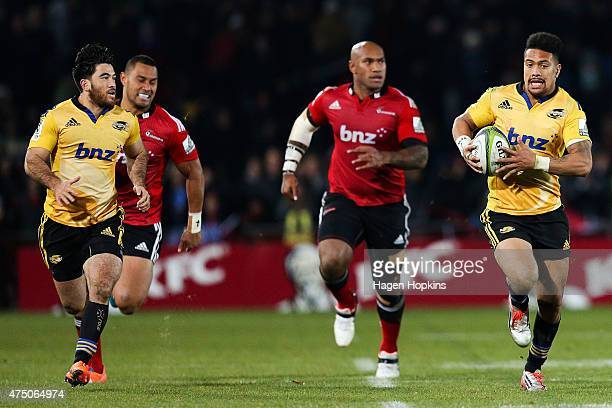 Ardie Savea of the Hurricanes makes a break with Nehe MilnerSkudder in support during the round 16 Super Rugby match between the Crusaders and the...