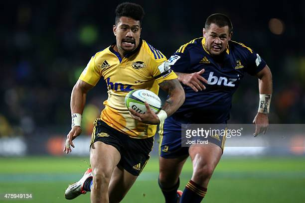 Ardie Savea of the Hurricanes runs with the ball during the round 17 Super Rugby match between the Hurricanes and the Highlanders at McLean Park on...