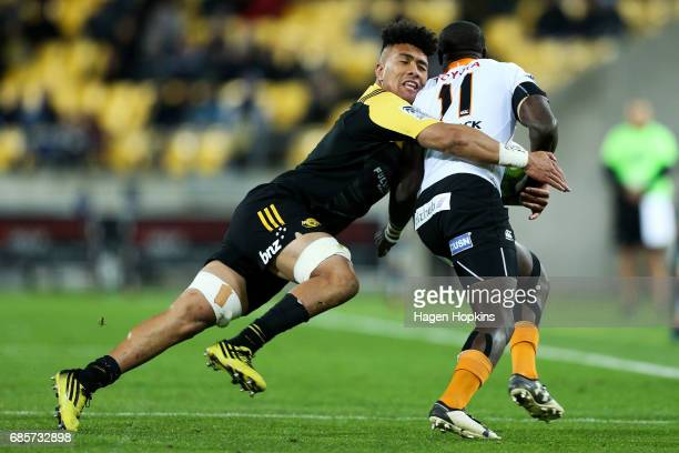 Ardie Savea of the Hurricanes tackles Raymond Rhule of the Cheetahs during the round 13 Super Rugby match between the Hurricanes and the Cheetahs at...