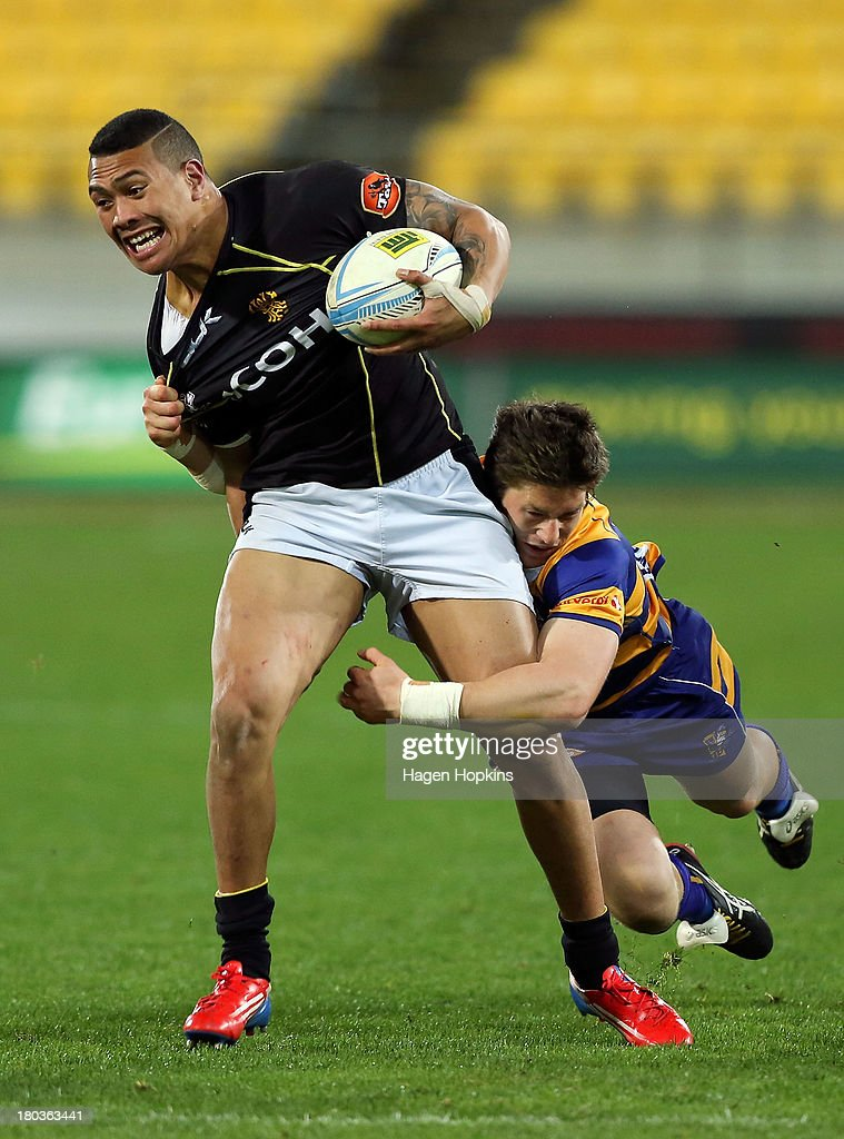 Ardie Savea of Wellington is tackled by Sam Beard of Bay of Plenty during the round 5 ITM Cup match between Wellington and the Bay of Plenty at Westpac Stadium on September 12, 2013 in Wellington, New Zealand.