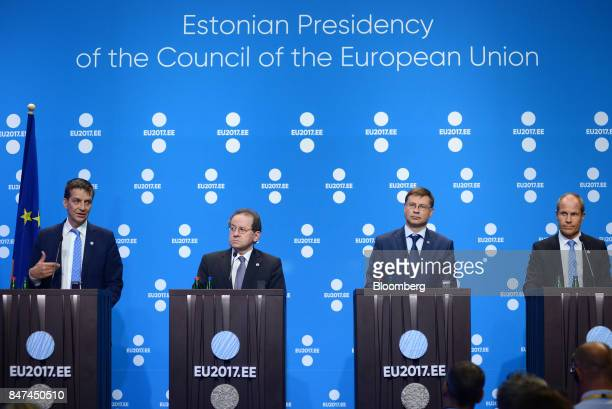 Ardo Hansson governor of Estonia's central bank from left speaks while Vitor Constancio vice president of the European Central Bank Valdis...