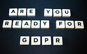 Close up of board game tiles/pieces spelling 'Are You Ready for GDPR'