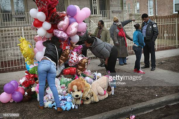 Area residents view a memorial for 6monthold Jonylah Watkins on March 14 2013 in Chicago Illinois Jonylah's father 29yearold Jonathan Watkins was...