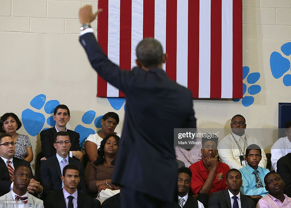Area youth listen to U.S. President <a gi-track='captionPersonalityLinkClicked' href=/galleries/search?phrase=Barack+Obama&family=editorial&specificpeople=203260 ng-click='$event.stopPropagation()'>Barack Obama</a> speak at the Walker Jones Education Campus, on July 21, 2014 in Washington, DC. President Obama spoke to area youth about My Brothers Keeper Initiative during a town hall meeting.