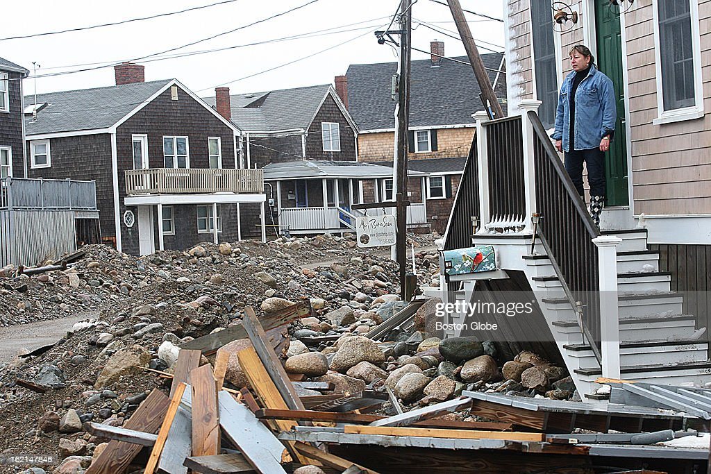 Areas in the town of Scituate are covered with storm debris after a blizzard hit New England. Paula Polaski looks out on the debris that has washed over Rebecca Road.