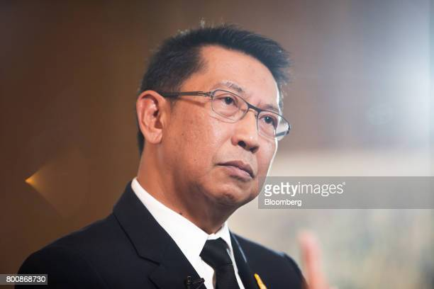Areepong BhoochaOom chairman of Thai Airways International Pcl listens during a Bloomberg Television interview on the sidelines of the Thailand's Big...