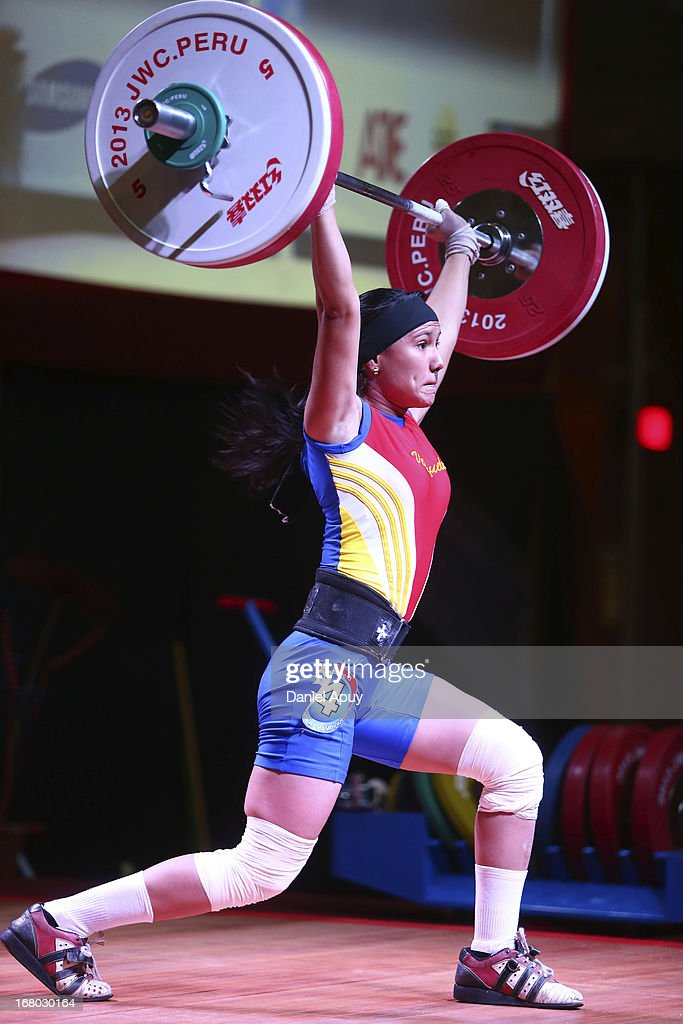 Areibis Lazaro of Venezuela B competes in the Women's 48kg during day one of the 2013 Junior Weightlifting World Championship at Maria Angola Convention Center on April 04, 2013 in Lima, Peru.