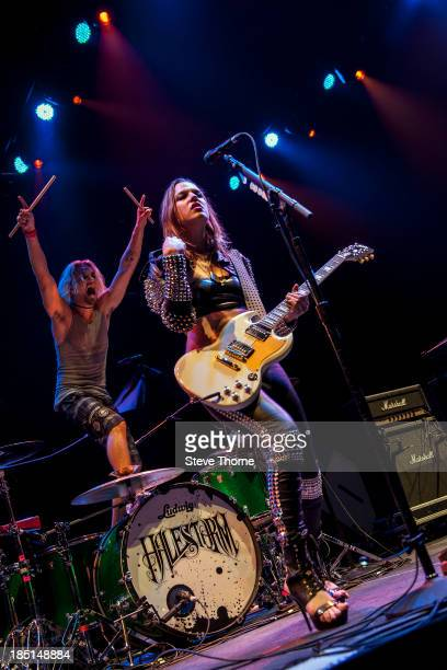 Arejay Hale and Lzzy Hale of Halestorm perform at NIA Arena on October 17 2013 in Birmingham England