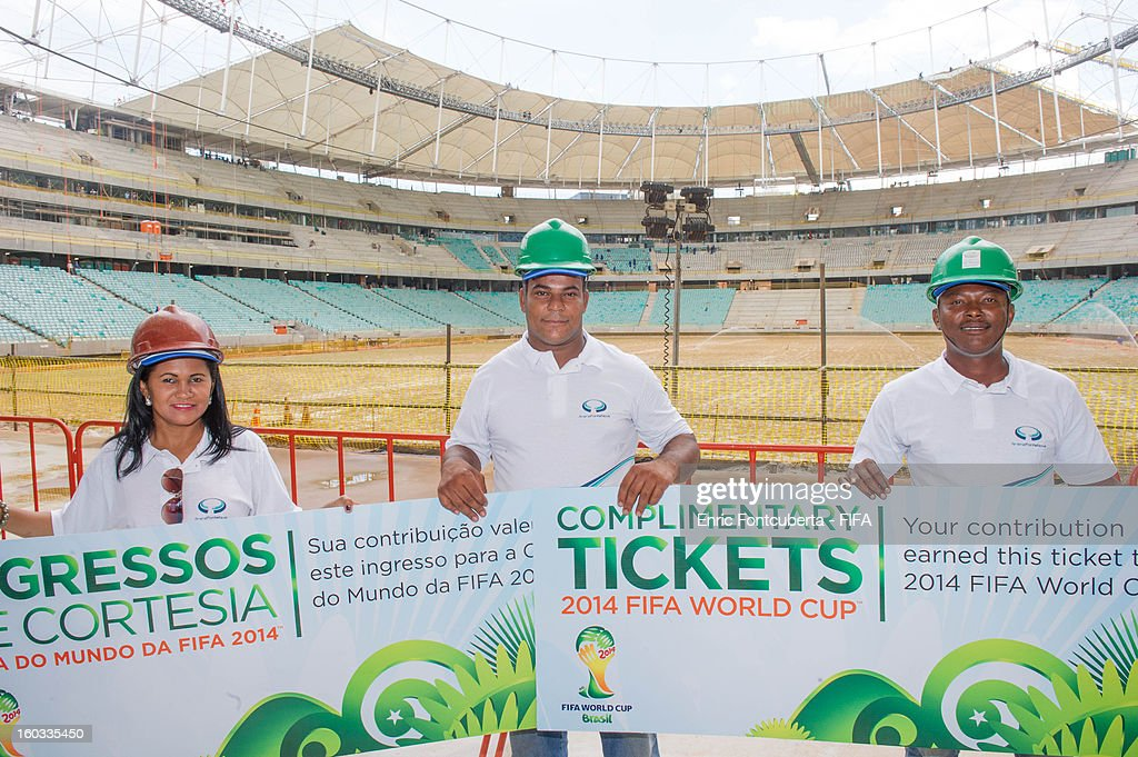Arena Fonte Nova Stadium construction workers receive 2014 World Cup symbolic tickets during 2014 FIFA World Cup Host City Tour at Salvador de Bahia, on January 29, 2013 in Brasilia, Brazil.