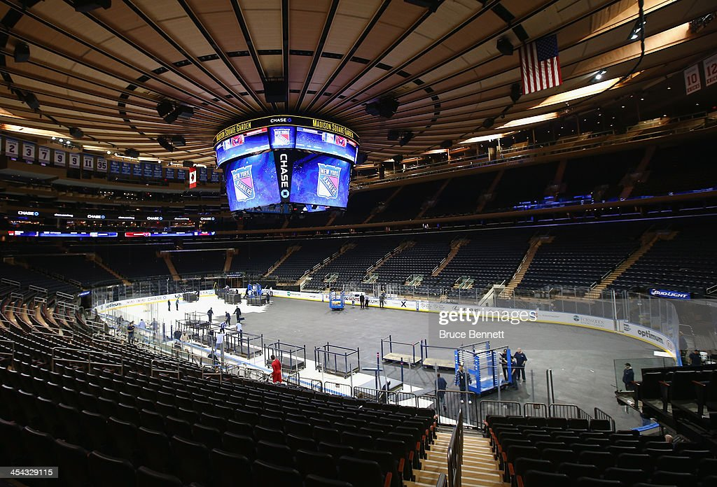 Arena workers convert madison square garden from basketball to hockey configuration on december Madison square garden basketball