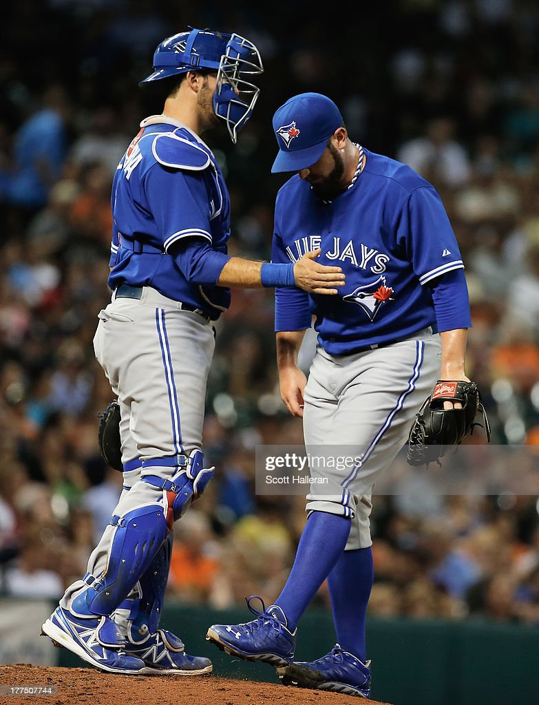 J.P. Arencibia #9 and Brad Lincoln #49 of the Toronto Blue Jays wait on the mound after Lincoln allowed two runs in the fifth inning against the Houston Astros at Minute Maid Park on August 23, 2013 in Houston, Texas.