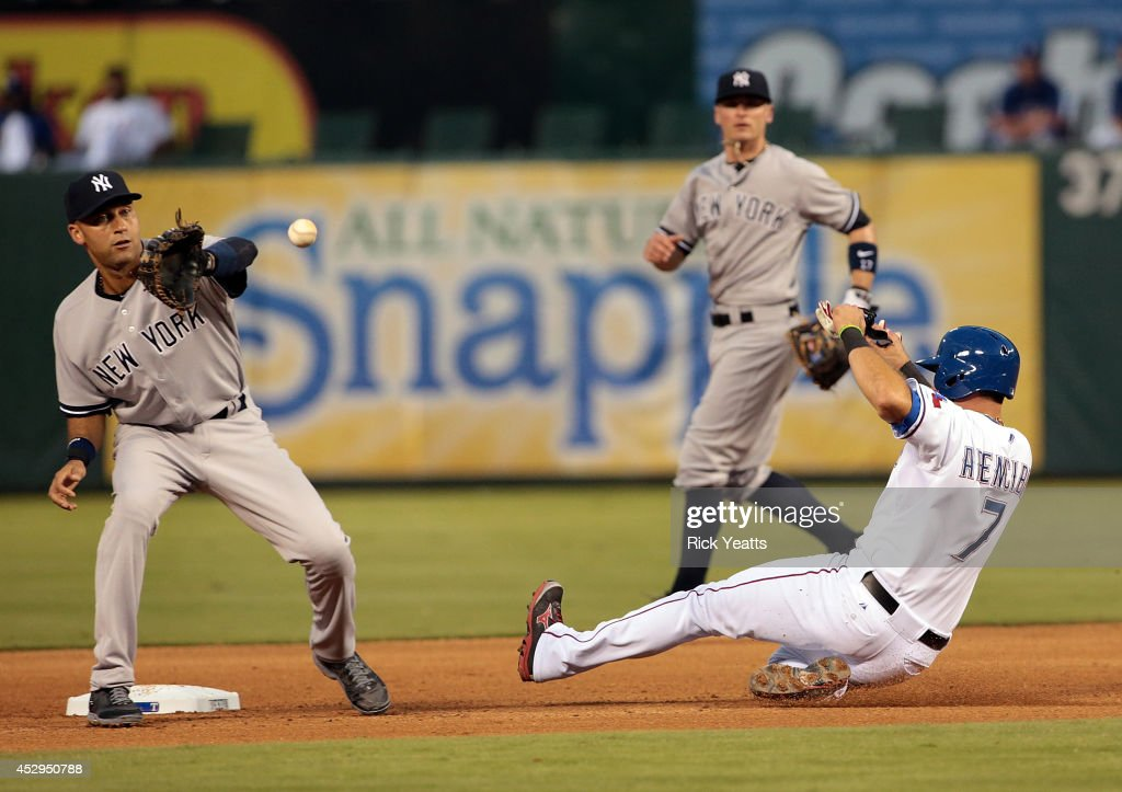 J.P. Arencibia #7 of the Texas Rangers steals second base in the fourth inning against Derek Jeter #2 of the New York Yankees at Globe Life Park in Arlington on July 30, 2014 in Arlington, Texas.