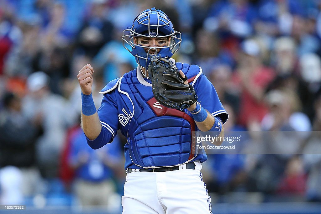 <a gi-track='captionPersonalityLinkClicked' href=/galleries/search?phrase=J.P.+Arencibia&family=editorial&specificpeople=4959430 ng-click='$event.stopPropagation()'>J.P. Arencibia</a> #9 of the Toronto Blue Jays celebrates the final out of their victory during MLB game action against the Baltimore Orioles on September 14, 2013 at Rogers Centre in Toronto, Ontario, Canada.